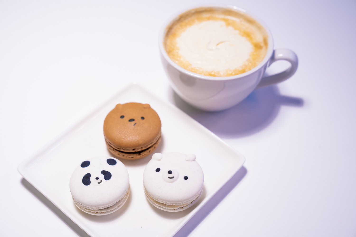 Coffee cup and plate with three We Bare Bears head macaroons