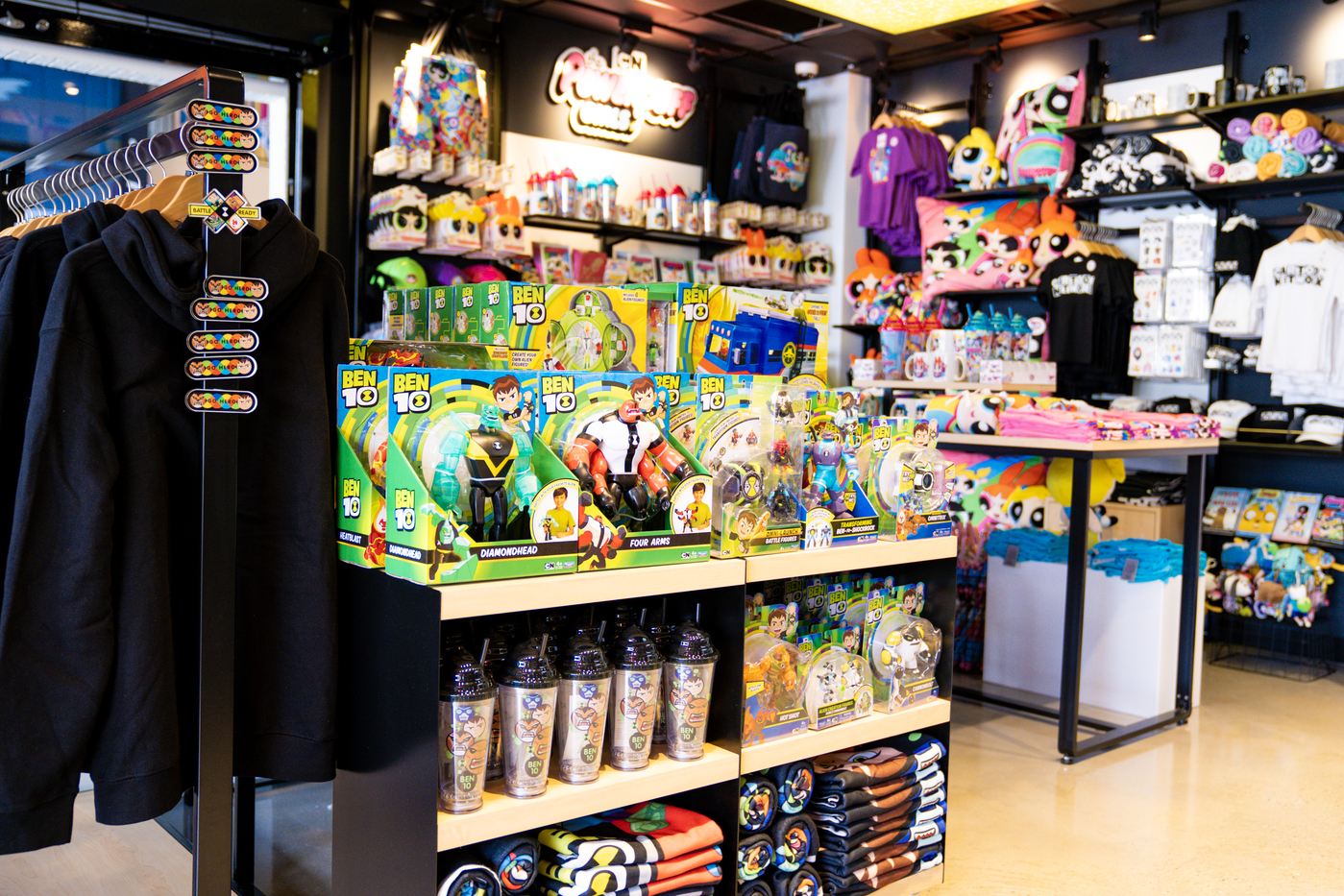 Close-up shot of colorful games and toys inside Cartoon Network Hotel store