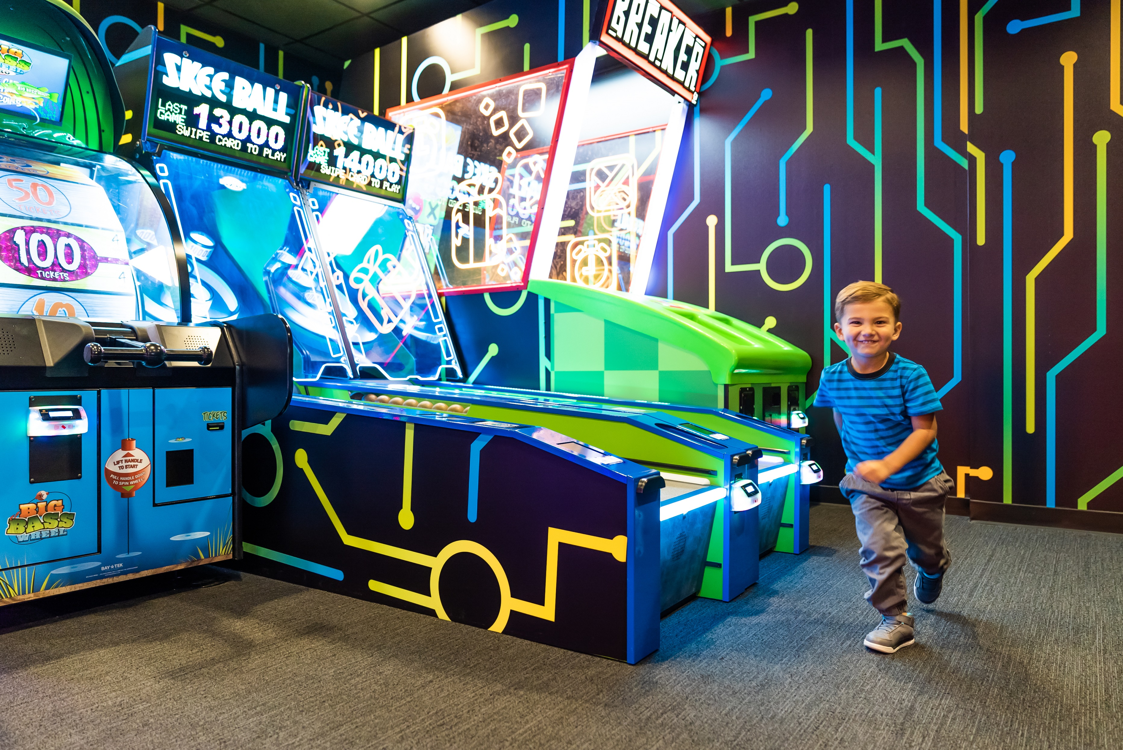 Boy running in the Omnitrix Arcade