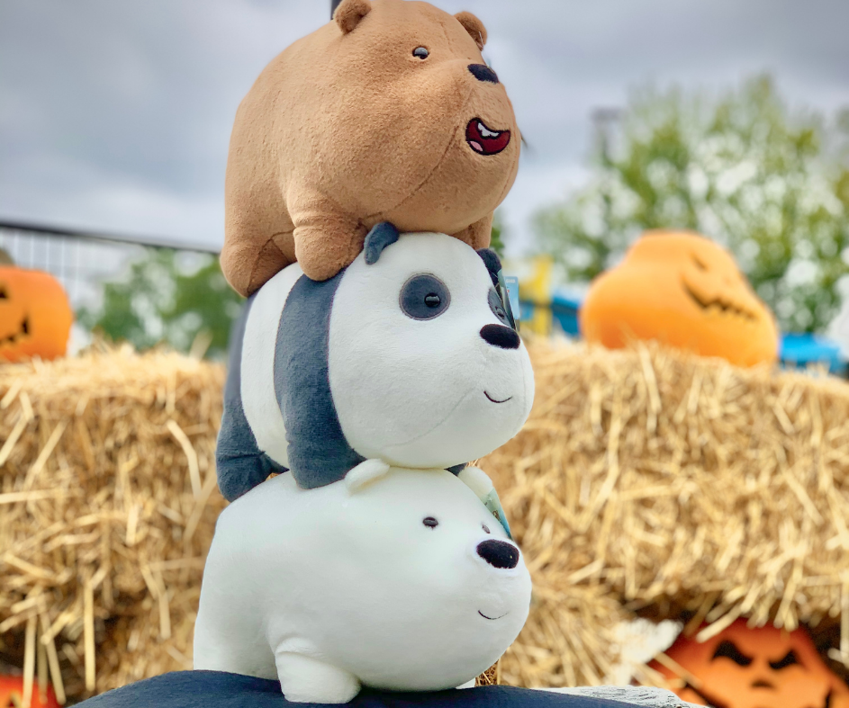 We Bare Bears stack of plush in front of hay bales and pumpkins.