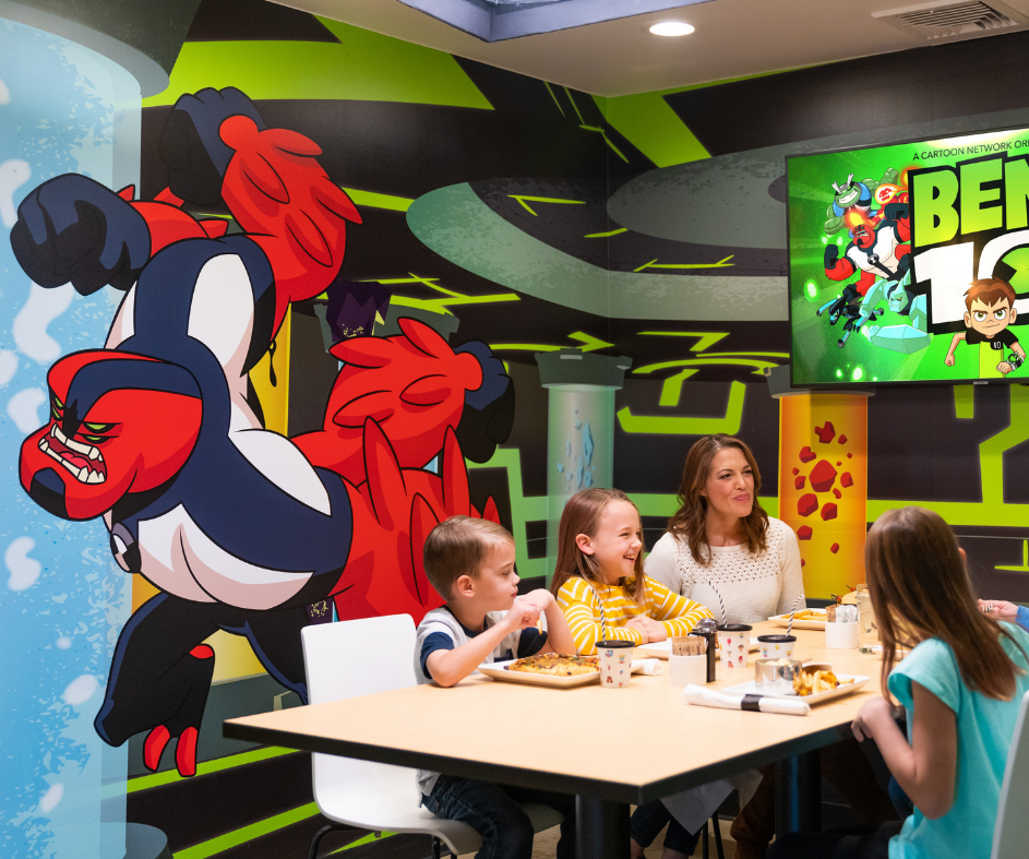 Family sitting and eating in a Ben 10 themed