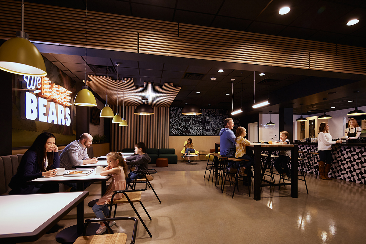 Families relax inside the dimly-lit cafe inside the Cartoon Network Hotel