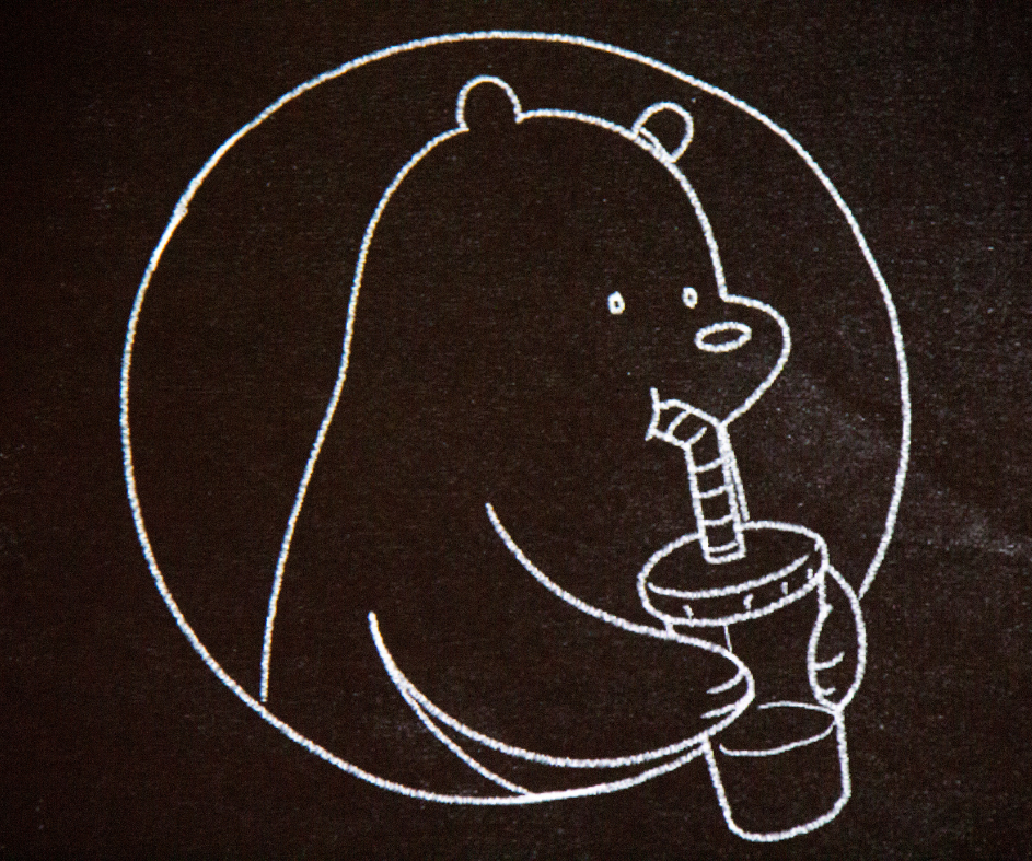 Drawing of Grizz drinking from a cup