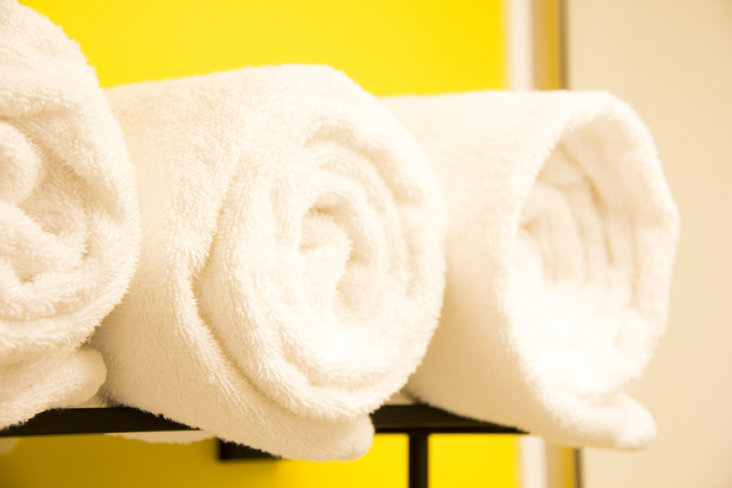 Three white towels rolled up